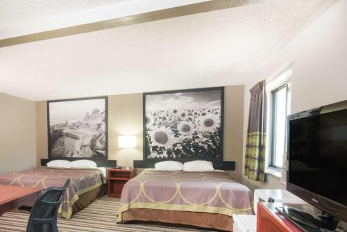 A bed or beds in a room at Super 8 by Wyndham Jamestown