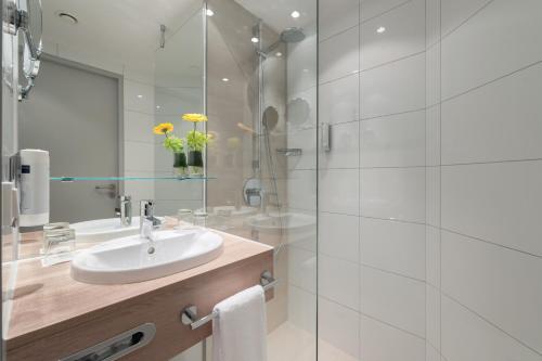Ein Badezimmer in der Unterkunft Essential by Dorint Stuttgart/Airport
