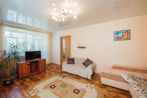 Гостиная зона в 2К Апартаменты на улице Громобоя