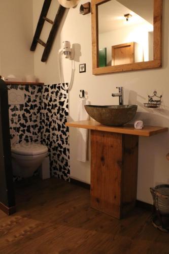 Ванная комната в Hostellerie de Genève