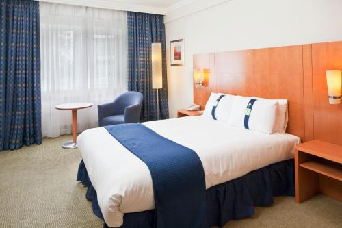 A bed or beds in a room at Holiday Inn Basildon, an IHG Hotel
