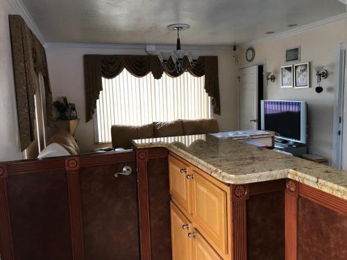 A kitchen or kitchenette at Red Carpet Inn Daytona Beach