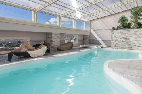 The swimming pool at or close to Hotel Donatello Imola
