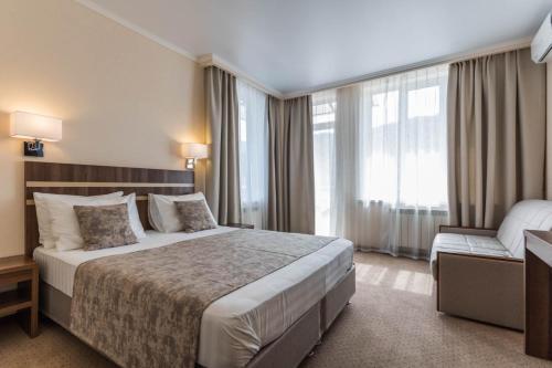 Кровать или кровати в номере Отель Чайка