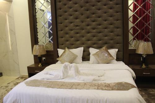 Cama ou camas em um quarto em Grand Plaza - Qurtubah
