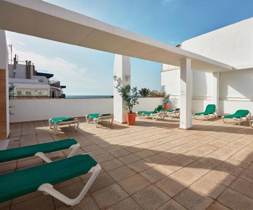 Un balcón o terraza de Aparthotel Milord's Suites