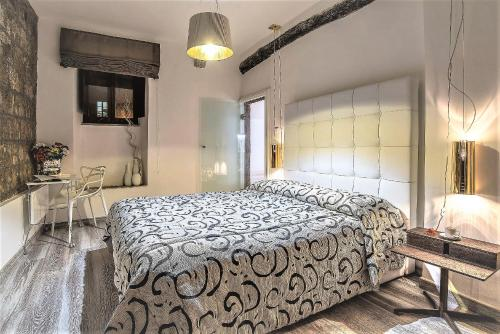A bed or beds in a room at iRoom Civita