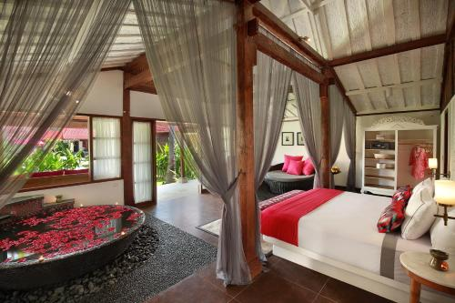 A bed or beds in a room at PinkCoco Gili Air
