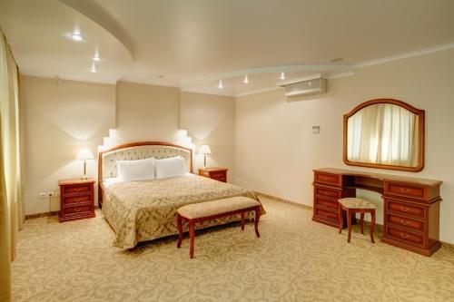 Кровать или кровати в номере Гостиница Урал