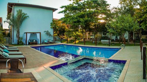 The swimming pool at or near Pousada Girassol