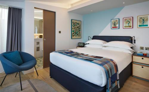 A bed or beds in a room at The Zetter Hotel