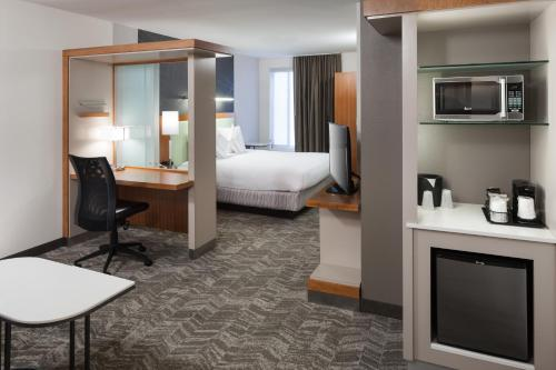 A bed or beds in a room at SpringHill Suites by Marriott Salt Lake City Airport