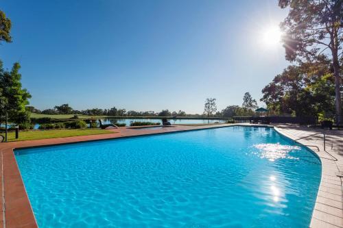 The swimming pool at or near Oaks Cypress Lakes Resort