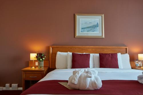 A bed or beds in a room at Future Inn Cardiff Bay