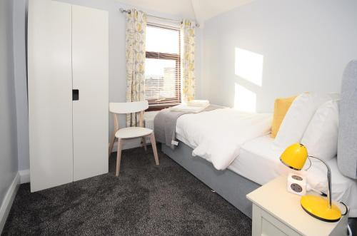 A bed or beds in a room at Northwood Park East