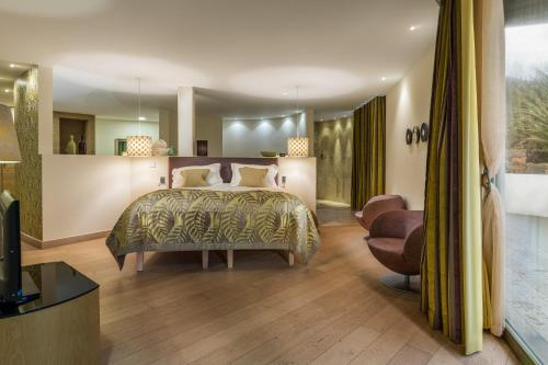 A bed or beds in a room at The Scarlet Hotel