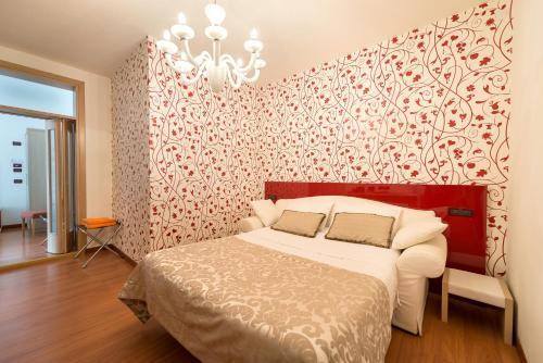 Letto o letti in una camera di Hotel Villa Angelina