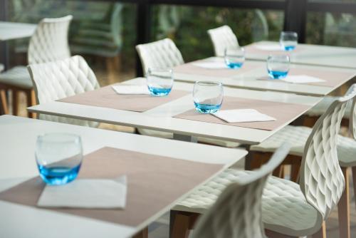 Restaurant ou autre lieu de restauration dans l'établissement Mercure Poitiers Site du Futuroscope