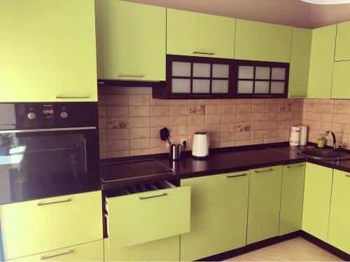 A kitchen or kitchenette at Apartment u Kafedralnogo Sobora