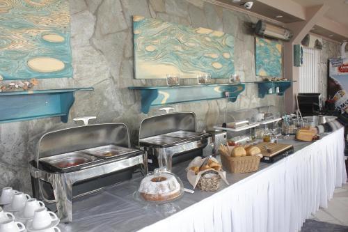 A kitchen or kitchenette at Santa Rosa Hotel & Beach