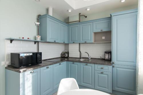 Кухня или мини-кухня в Apartment Zima-Leto