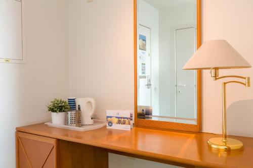 A kitchen or kitchenette at Aparthotel Blankenberge