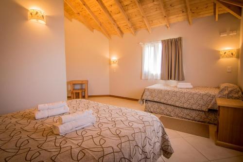 Una cama o camas en una habitación de Patagonia Hostel