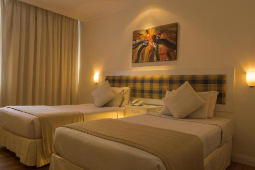 A bed or beds in a room at The Jerai Hotel Alor Star