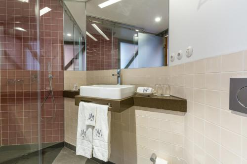A bathroom at Lisbon Wine Hotel