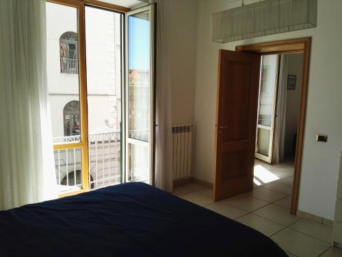 A bed or beds in a room at Indipendenza