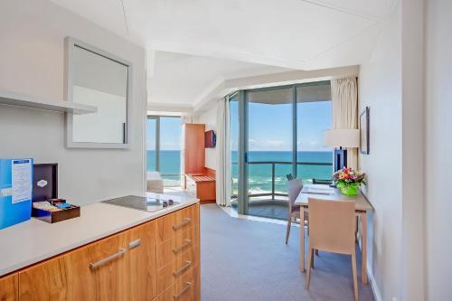 A kitchen or kitchenette at Mantra Legends Hotel