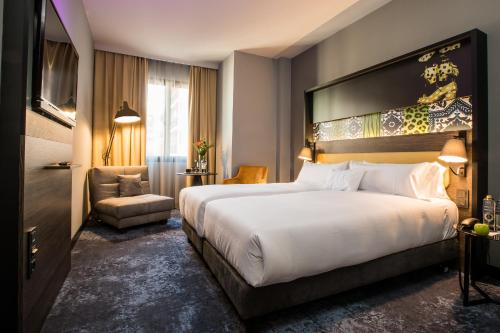 A bed or beds in a room at NYX Hotel Madrid by Leonardo Hotels