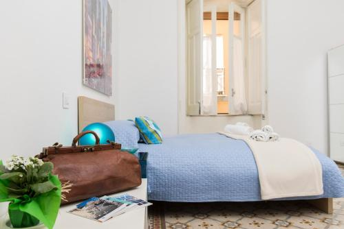 A bed or beds in a room at Bed&Breakfast Salerno