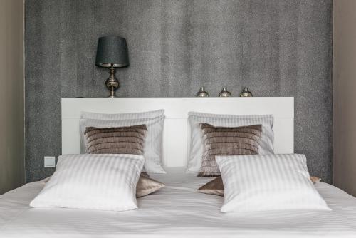 Łóżko lub łóżka w pokoju w obiekcie Apartament Milano Avanti