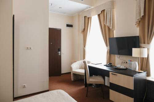 Телевизор и/или развлекательный центр в Бутик Отель Модерн