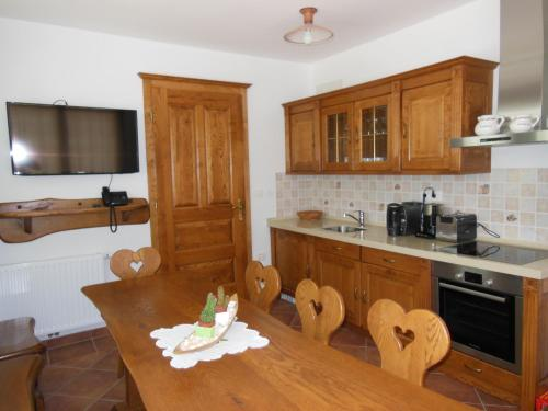 A kitchen or kitchenette at Šport center Prodnik