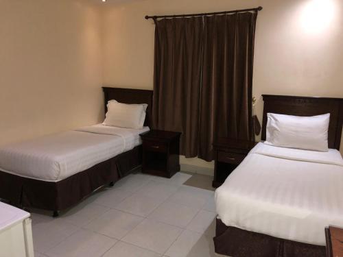 Cama ou camas em um quarto em The Blue Bow