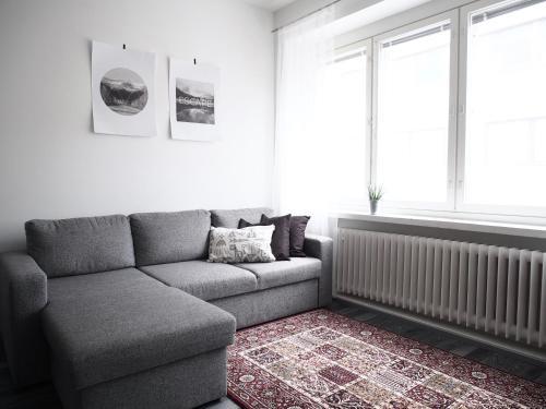 "Oleskelutila majoituspaikassa 2ndhomes Tampere ""Koskipuisto"" Apartment - Premium Downtown Apt with Own Sauna & a Tapas Restaurant Downstairs"