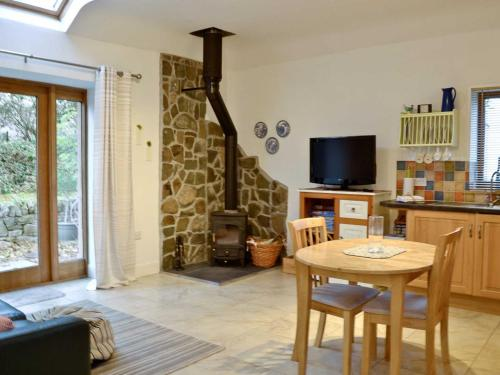 A television and/or entertainment center at Appletree Cottage