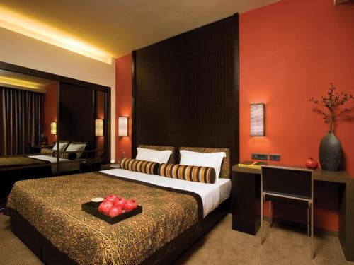 A bed or beds in a room at Dan Boutique Hotel Jerusalem
