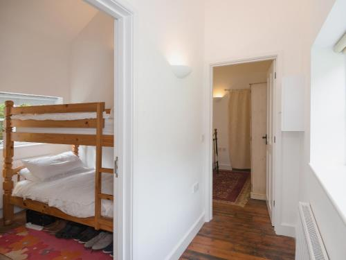 A bunk bed or bunk beds in a room at Millpool Cottage