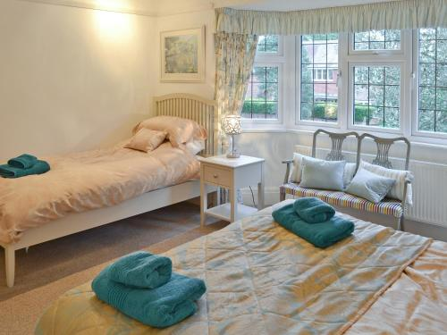A bed or beds in a room at Holme Cottage