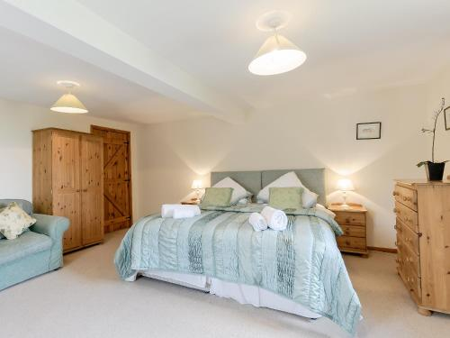 A bed or beds in a room at The Dovecote