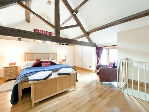 A bed or beds in a room at The Smithy