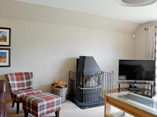 A television and/or entertainment centre at Lochnagar Lodge