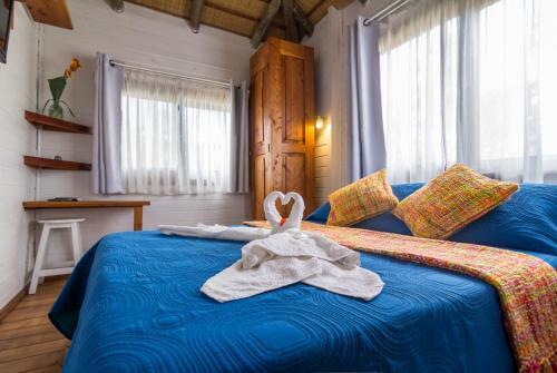 Cama o camas de una habitación en Posada Lune de Miel