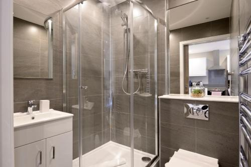 A bathroom at Destiny Scotland Apartments at Nelson Mandela Place