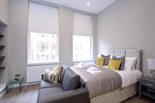 A bed or beds in a room at Destiny Scotland Apartments at Nelson Mandela Place