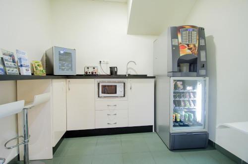 A kitchen or kitchenette at Hotel Solymar