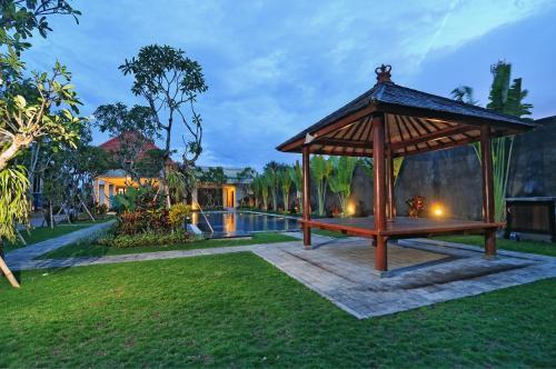 A garden outside Taman Ayu Town House